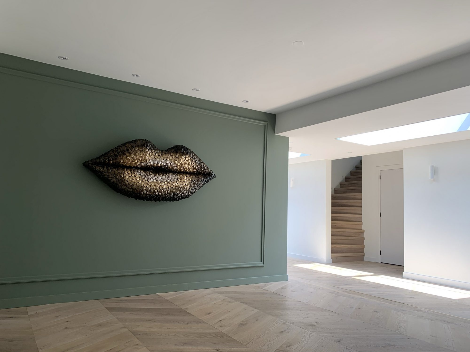 bronze ombre lips artwork on the wall unique 3D art for your interior made from recycled materials, e.g. from discarded waxine cups and crown caps